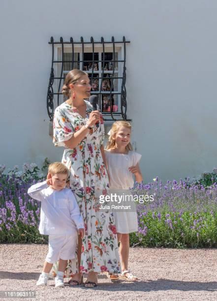 Crown Princess Victoria of Sweden addresses the audience alongside her children Prince Oscar and Princess Estelle her husband Prince Daniel and her...