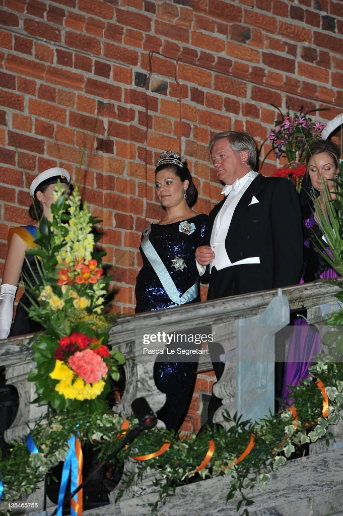 Crown Princess Victoria of Sweden (C) and Australian Nobel Prize for Physics laureate Brian Schmidt (2 R) arrive for the Nobel Prize Banquet at Stockholm City Hall on December 10, 2011 in Stockholm, Sweden.
