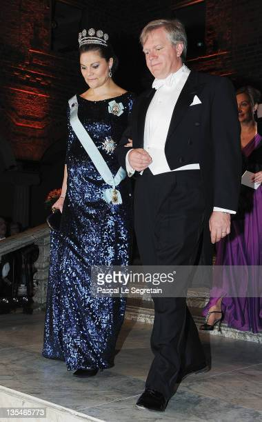 Crown Princess Victoria of Sweden and Australian Nobel Prize for Physics laureate Brian Schmidt arrive for the Nobel Prize Banquet at Stockholm City...