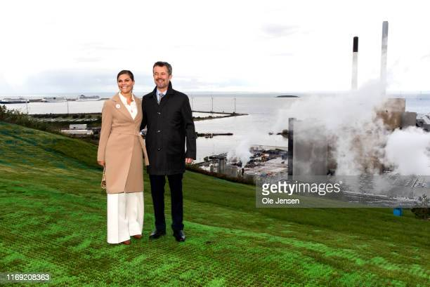 Crown Princess Victoria of Sweden and Crown Prince Frederik of Denmark pose at the top of the power plant Amager Bakke on September 18, 2019 in...