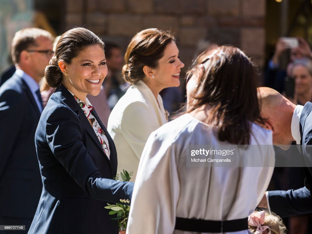 Crown Princess Victoria of Sweden and Crown Princess Mary of Denmark speak with Soren Lyndggaard and Hanna Lyndggaard at Ole Lyndggaard Copenhagen store on May 29, 2017 in Stockholm, Sweden.