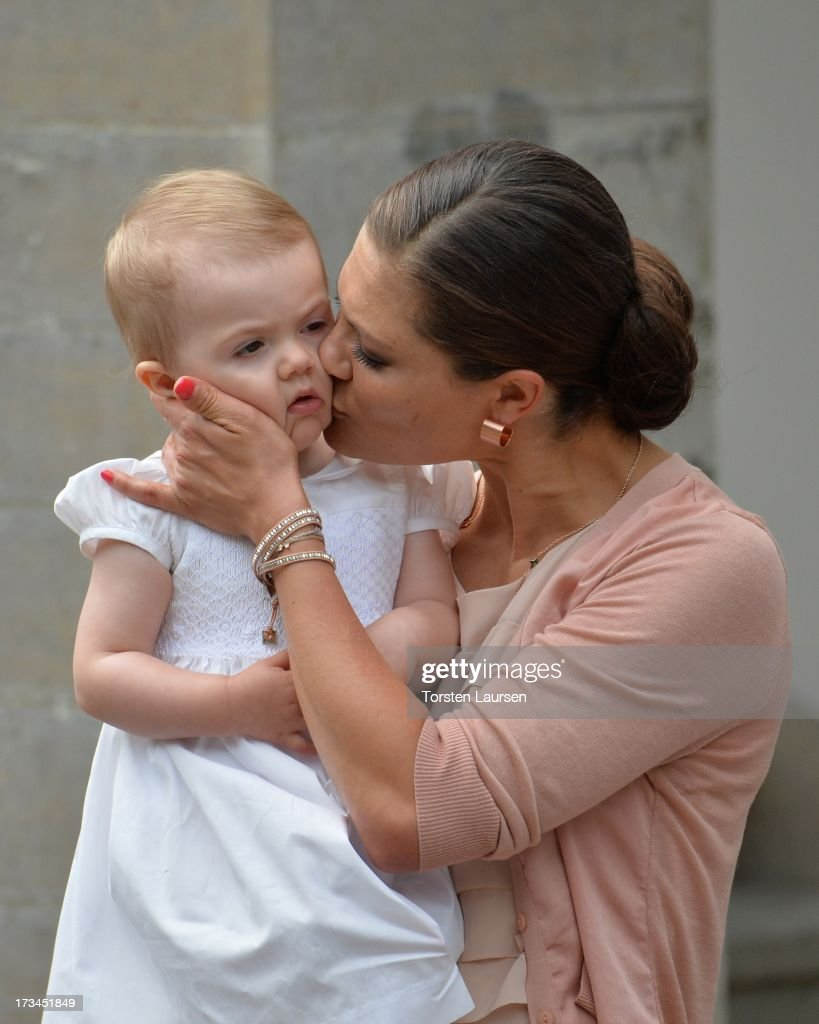 Crown Princess Victoria of Sweden and daughter Princess Estelle of Sweden attend Victoria Day celebrations at Solliden Castle on July 14, 2013 in Borgholm, Sweden.