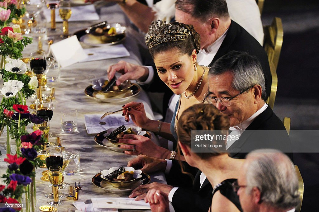 Crown Princess Victoria of Sweden (C) and Ei-ichi Negishi, Nobel Chemistry Laureate (C,R), attend the Nobel Banquet at the Stockholm City Hall on December 10, 2010 in Stockholm, Sweden. The banquet features a three-course dinner, entertainment and dancing.