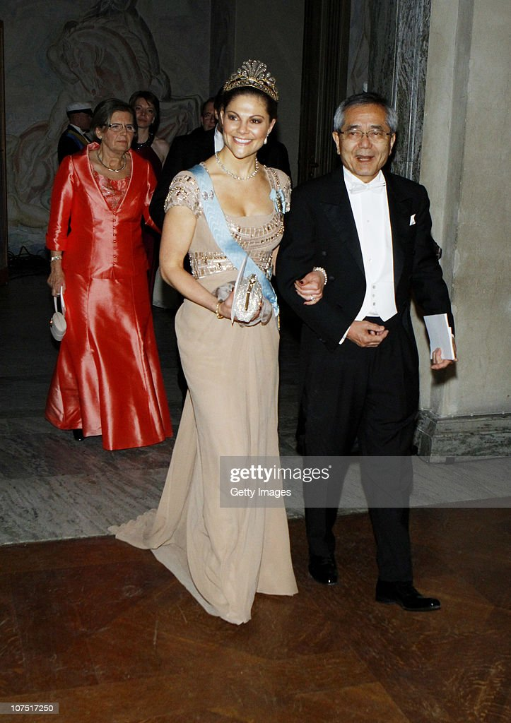 Crown Princess Victoria of Sweden and Ei-ichi Negishi, Nobel Chemistry Laureate, arrive to the Nobel Banquet at the Stockholm City Hall on December 10, 2010 in Stockholm, Sweden. The banquet features a three-course dinner, entertainment and dancing.