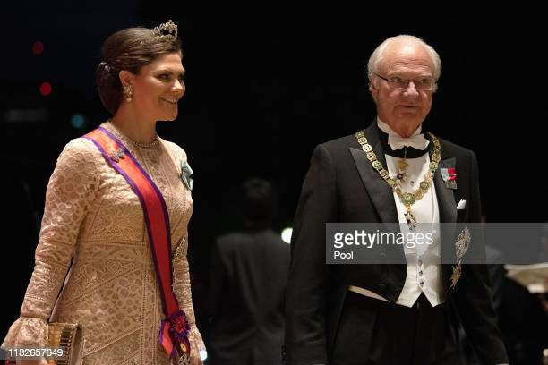 Crown Princess Victoria of Sweden and her father Carl XVI Gustaf of Sweden arrive at the Imperial Palace for the Court Banquets after the Ceremony of...