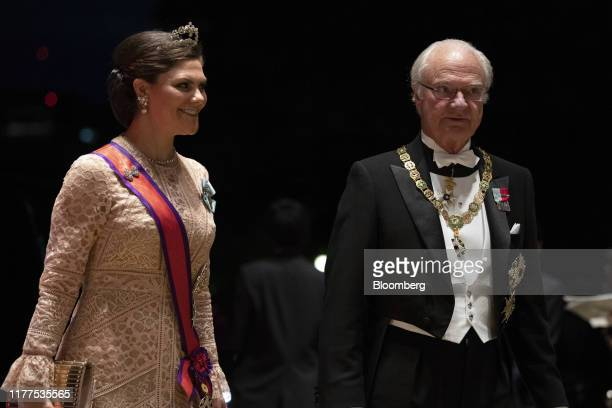 Crown Princess Victoria of Sweden and her father Sweden's King Carl XVI Gustaf arrive for the banquet after the enthronement ceremony at the Imperial...