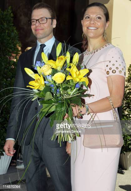 Crown Princess Victoria of Sweden and her husband Prince Daniel Duke of Vastergotland arrive at Munich Hofgarten on May 24 2011 in Munich Germany