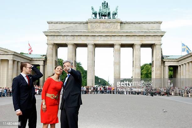 Crown Princess Victoria of Sweden and her husband Prince Daniel Duke of Vastergotland speak to Berlin Mayor Klaus Wowereit during their visit of the...