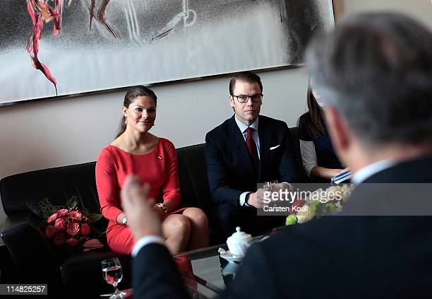 Crown Princess Victoria of Sweden and her husband Prince Daniel Duke of Vastergotland speak with Berlin Mayor Klaus Wowereit at City Hall on May 27...