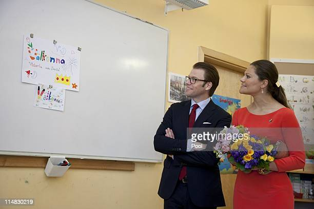 Crown Princess Victoria of Sweden and her husband Prince Daniel Duke of Vastergotland visit a classroom at the Swedish School on May 27 2011 in...