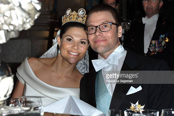 Crown Princess Victoria of Sweden and her husband prince Daniel attend their wedding banquet at the Royal Palace on June 19, 2010 in Stockholm,...