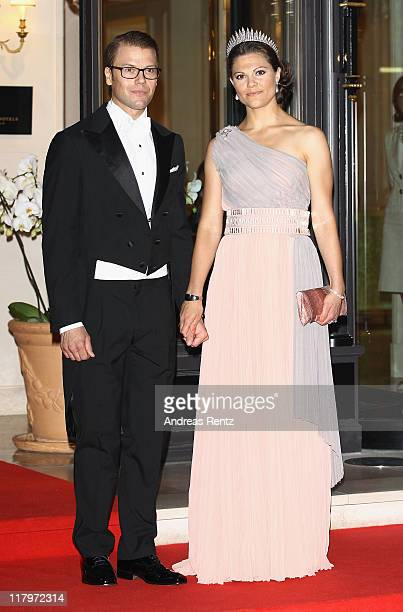Crown Princess Victoria of Sweden and husband Prince Daniel Duke of Vastergotland leave the Hotel Hermitage to attend a dinner at Opera terraces...