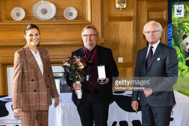 Crown Princess Victoria of Sweden and King Carl XVI Gustaf of Sweden award the 2022 Botanist prize to Mora Aronsson during the WWFs annual meeting at...