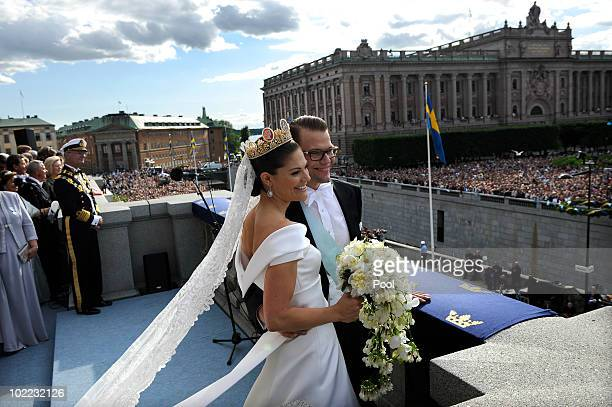 Crown Princess Victoria of Sweden and Prince Daniel Duke of Vastergotland appear on the balcony to acknowledge spectators at The Royal Palace in...