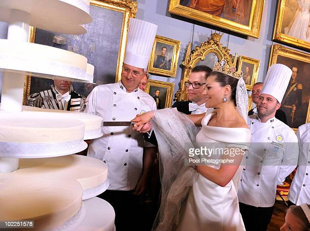 Crown Princess Victoria of Sweden and Prince Daniel Duke of Vastergotland cut their wedding cake during the Wedding Banquet at the Royal Palace on...