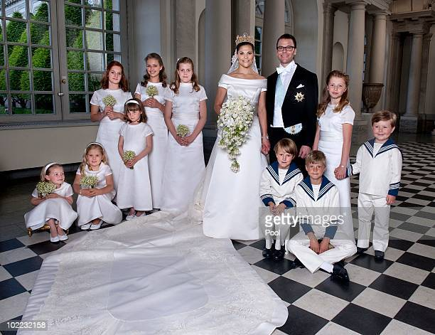 Crown Princess Victoria of Sweden and Prince Daniel, Duke of Vastergotland pose after their wedding with bridesmaids and page boys Vera Blom,...