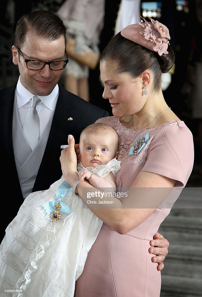 Crown Princess Victoria of Sweden and Prince Daniel of Sweden attend the christening of their daughter and new Swedish heir to the throne Princess Estelle Silvia Ewa Mary of Sweden at The Royal Palace on May 22, 2012 in Stockholm, Sweden.