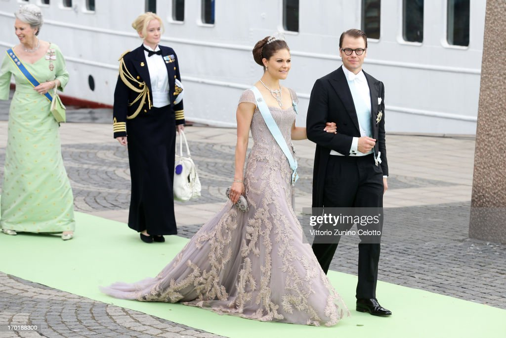 Crown Princess Victoria of Sweden and Prince Daniel of Sweden depart for the banquet after the wedding ceremony of Princess Madeleine of Sweden and Christopher O'Neill hosted by King Carl Gustaf XIV and Queen Silvia at The Royal Palace on June 8, 2013 in Stockholm, Sweden.