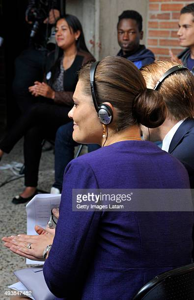 Crown Princess Victoria of Sweden and Prince Daniel of Sweden listen to a group of youngsters during a visit to the enterprise driven project 'Ruta...