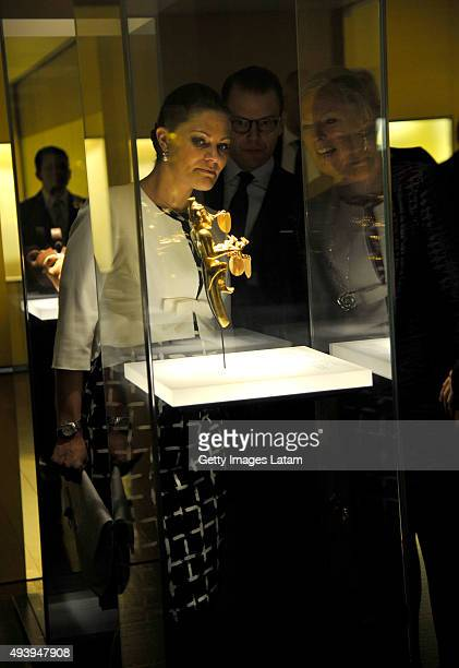 Crown Princess Victoria of Sweden and Prince Daniel of Sweden look at a prehispanic gold piece during a visit to the Gold Museum on October 23, 2015...