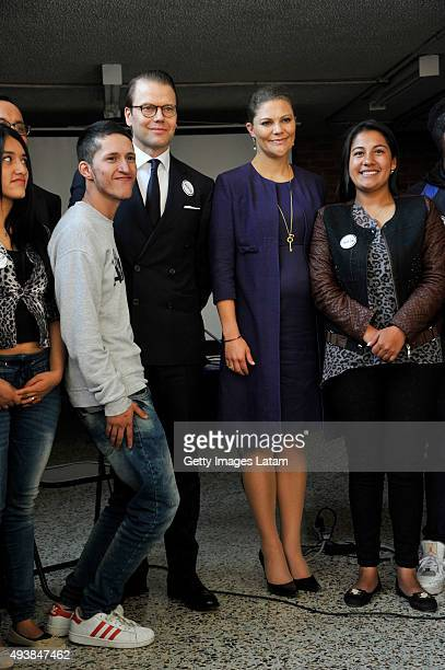 Crown Princess Victoria of Sweden and Prince Daniel of Sweden pose for a picture with youngsters during a visit to the enterprise driven project...