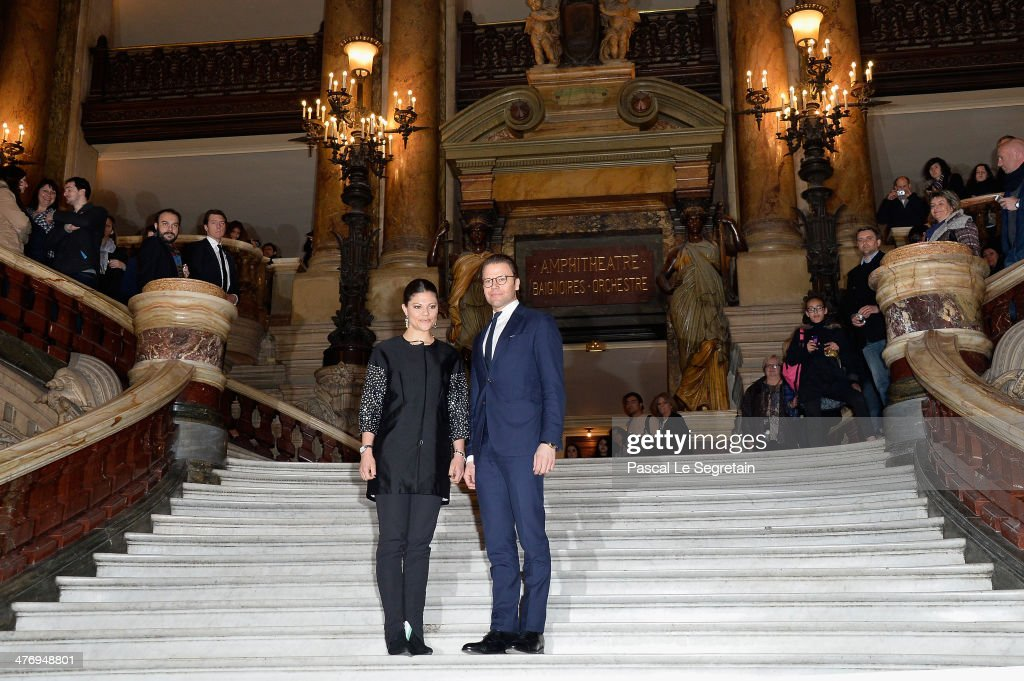 Crown Princess Victoria of Sweden and Prince Daniel of Sweden pose on the Grand Escalier of the Opera Garnier on March 6, 2014 in Paris, France.
