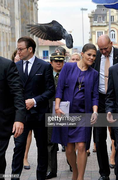 Crown Princess Victoria of Sweden and Prince Daniel of Sweden walk down a street of downtown Bogota after holding a private meeting with Colombia's...