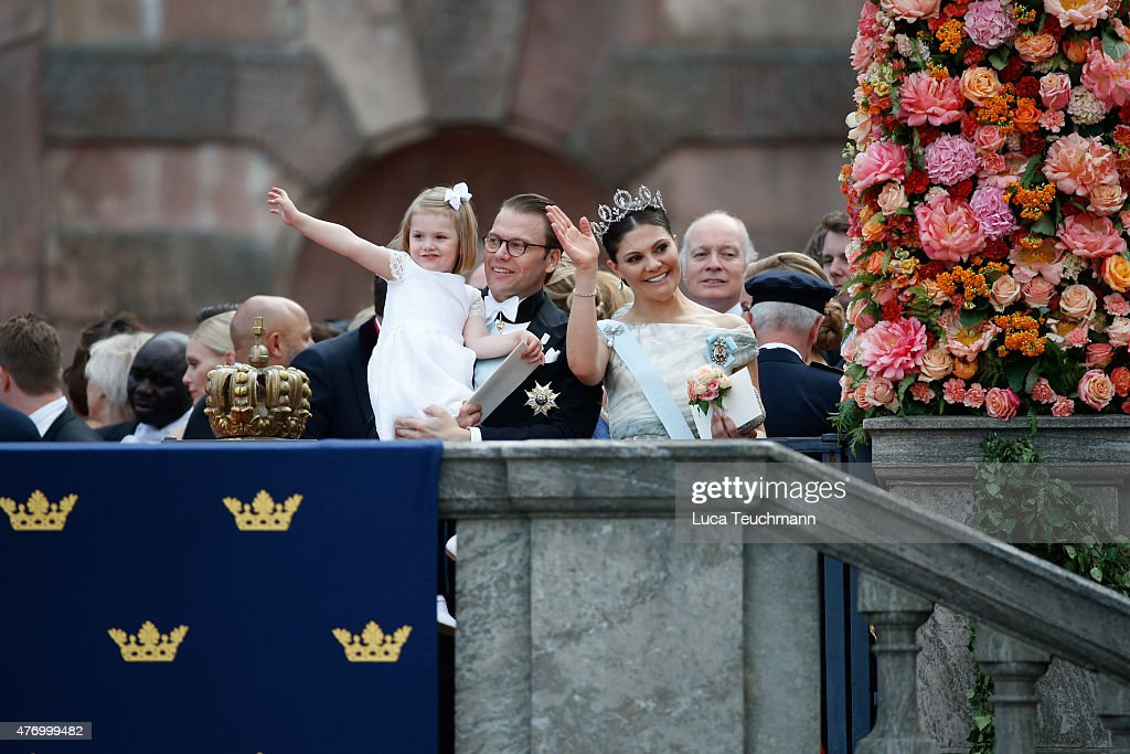 Crown Princess Victoria of Sweden and Prince Daniel with Princess Estelle greet the crowds after departing the Royal Palace Chapel on June 13, 2015 in Stockholm, Sweden.