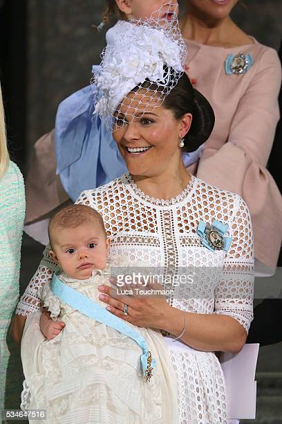 Crown Princess Victoria of Sweden and Prince Oscar of Sweden are seen at The Royal Palace for the Christening of Prince Oscar of Sweden on May 27...