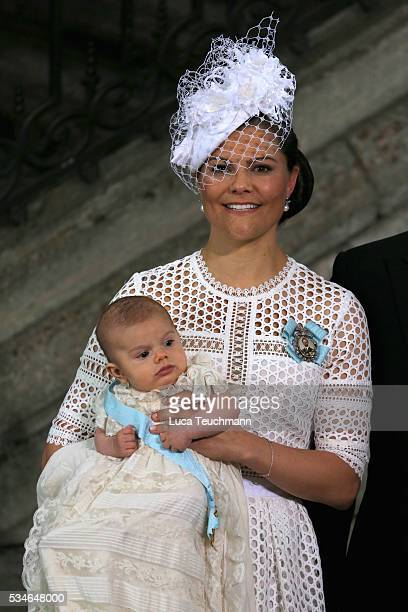 Crown Princess Victoria of Sweden and Prince Oscar of Sweden are seen at The Royal Palace for the Christening of Prince Oscar of Sweden on May 27,...