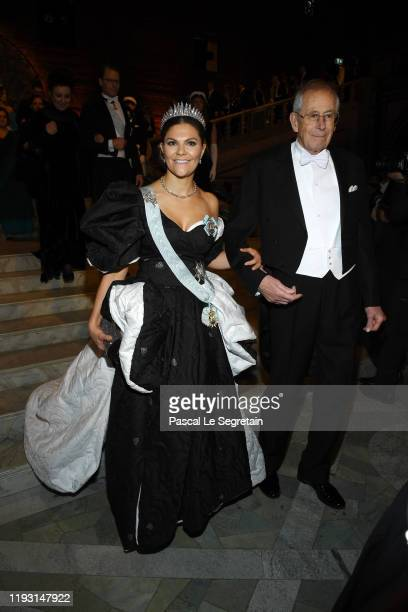 Crown Princess Victoria of Sweden and Professor Emeritus James Peebles, laureate of the Nobel Prize in Physics arrive at the Nobel Prize Banquet 2018...