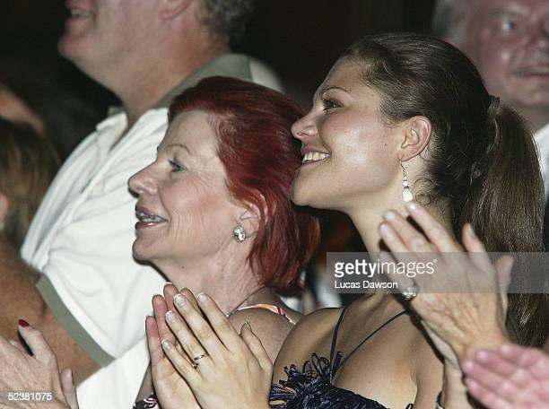 Crown Princess Victoria of Sweden applauds after a performance of Mama Mia March 13 2005 in Melbourne Australia