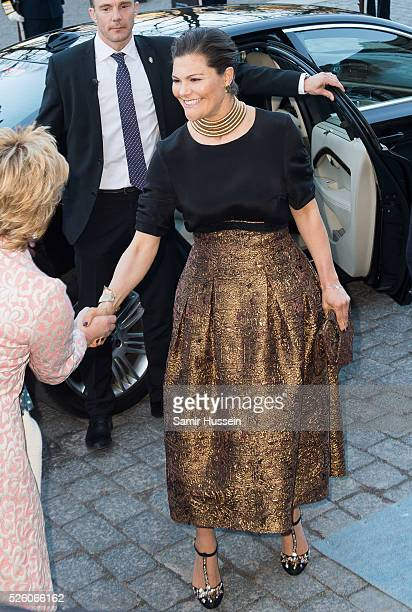 Crown Princess Victoria of Sweden arrives at the Nordic Museum to attend a concert of the Royal Swedish Opera and Stockholm Concert Hall to celebrate...