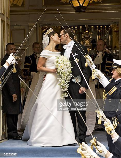 Crown Princess Victoria of Sweden, Duchess of Vastergotland and her husband Prince Daniel of Sweden, Duke of Vastergotland kiss as they leave...