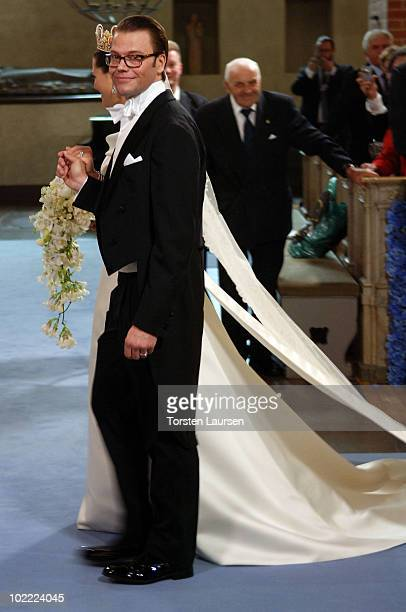 Crown Princess Victoria of Sweden Duchess of Västergötland and her husband Prince Daniel Duke of Västergötland leave the cathedral after their...