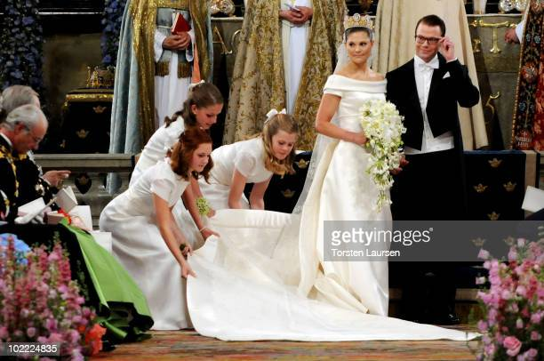 Crown Princess Victoria of Sweden Duchess of Västergötland and her husband Prince Daniel Duke of Västergötland are seen leaving the cathedral after...