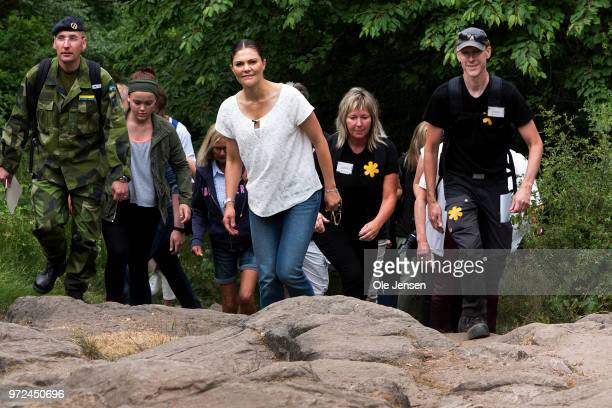 Crown Princess Victoria of Sweden during a hiking tour through partly Stenshuvud National Park and Vitemoella National Park on June 12 2018 in...