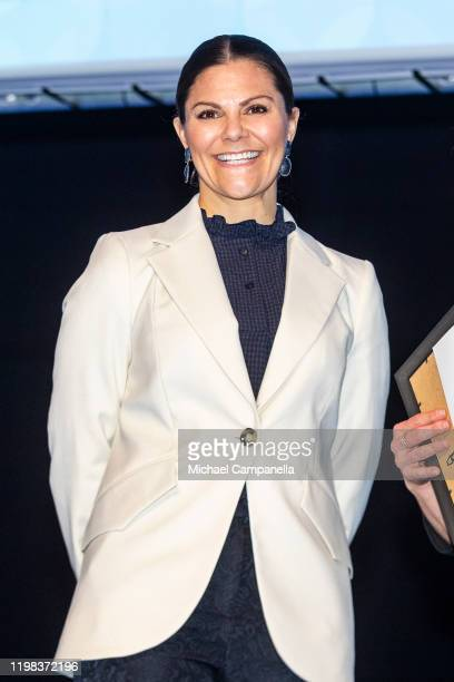 Crown Princess Victoria of Sweden gives out prizes to health care professionals during a seminar on cancer strategy at the Karolinska Institute on...