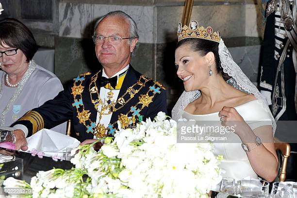 Crown Princess Victoria of Sweden her father King Carl Gustaf of Sweden and Ewa Westling attend their wedding banquet at the Royal Palace on June 19...