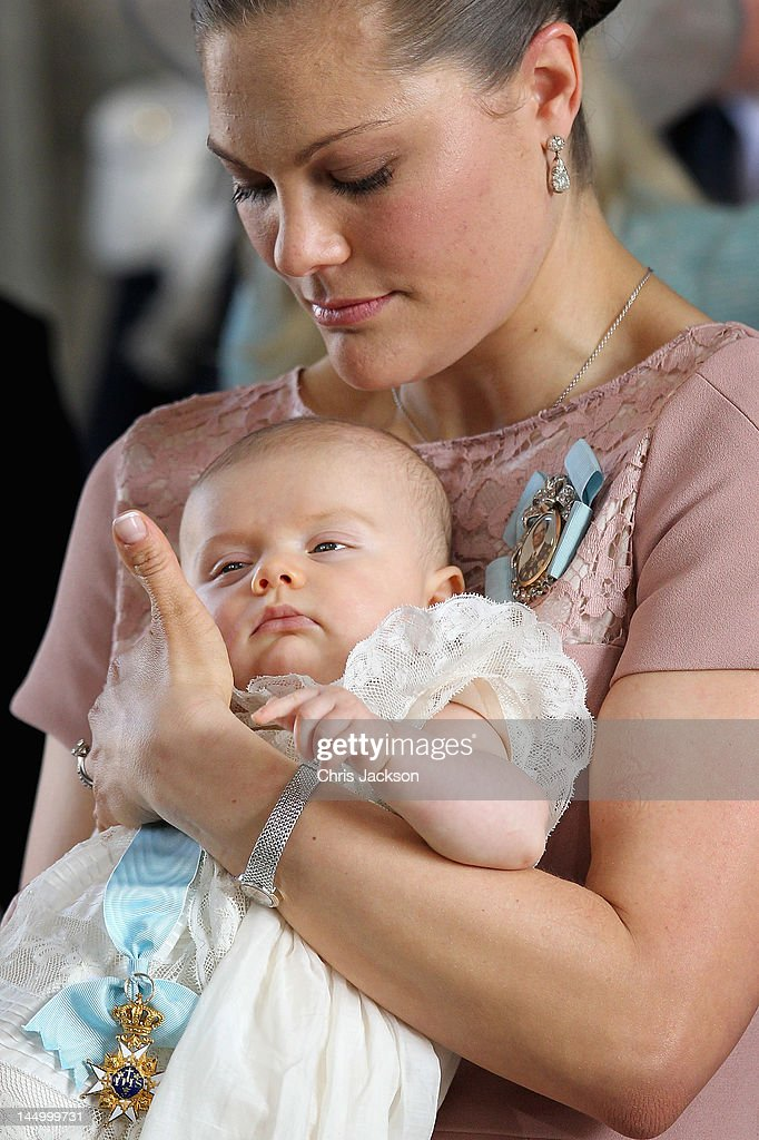 Crown Princess Victoria of Sweden holds her daughter Princess Estelle Silvia Ewa Mary of Sweden during her christening at The Royal Palace on May 22, 2012 in Stockholm, Sweden.