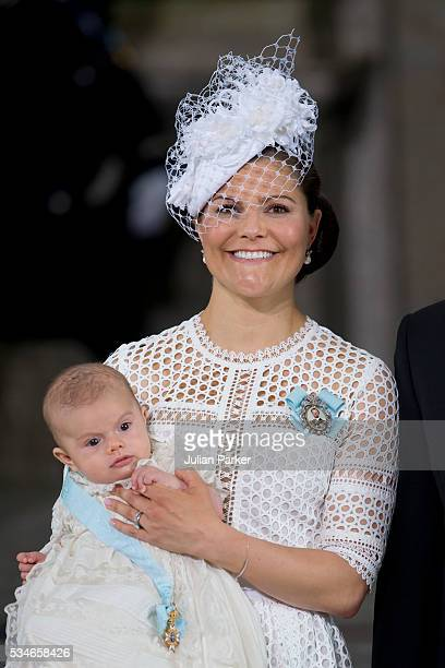 Crown Princess Victoria of Sweden holds Prince Oscar Duke of Skane after the ceremony at the Royal Palace in Stockholm for the Christening of Prince...