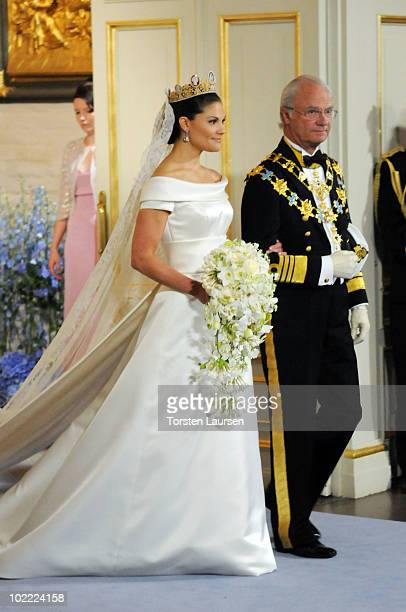 Crown Princess Victoria of Sweden is led into the church by her father the king Carl Gustaf of Sweden prior to the wedding ceremony between Crown...