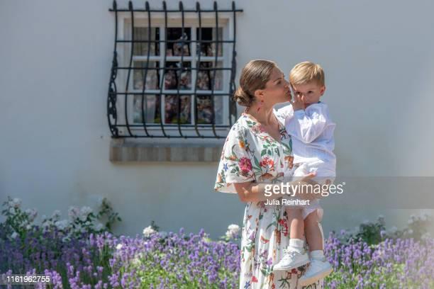Crown Princess Victoria of Sweden kisses her son Prince Oscar during The Crown Princess Victoria of Sweden's 42nd birthday celebrations on July 14...