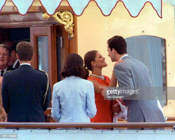 Crown Princess Victoria Of Sweden Kissing Prince Felipe Of Spain On The Queen Of Denmark's Yacht In London