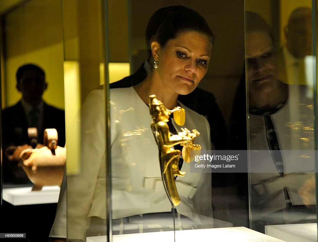 Crown Princess Victoria of Sweden looks at a prehispanic gold piece during a visit to the Gold Museum on October 23, 2015 in Bogota, Colombia.