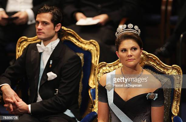 Crown Princess Victoria of Sweden looks on with Prince Carl Philip of Sweden during the Nobel Foundation Prize 2007 Awards Ceremony at the Concert...