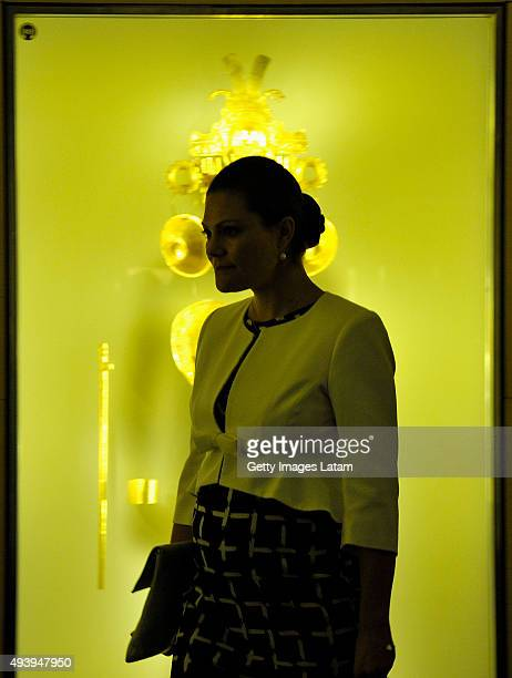 Crown Princess Victoria of Sweden passes by a prehispanic gold piece during a visit to the Gold Museum on October 23, 2015 in Bogota, Colombia.