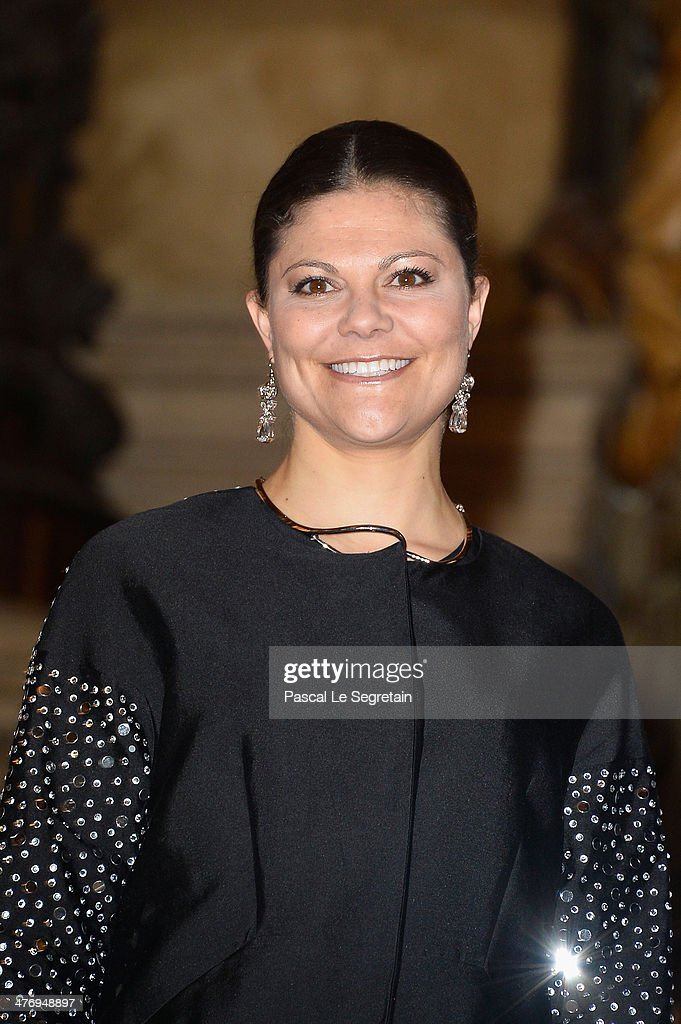 Crown Princess Victoria of Sweden poses on the Grand Escalier of the Opera Garnier on March 6, 2014 in Paris, France.