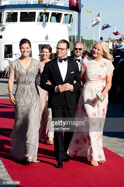 Crown Princess Victoria of Sweden Prince Daniel of Sweden and Crown Princess MetteMarit of Norway arrive to board the S/S Stockholm to travel to a...