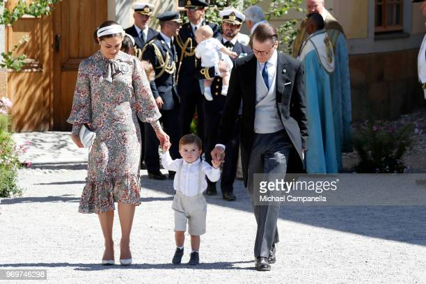 Crown Princess Victoria of Sweden Prince Oscar of Sweden and Prince Daniel of Sweden pose after the christening of Princess Adrienne of Sweden at...